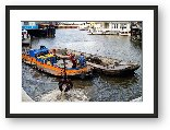 Buy Print of Garbage picker and barge grabbing bikes from the canal
