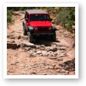 Jeep Rubicon taking some rock steps