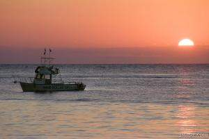 Sunset and dive boat