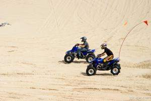 Quads riding in dunes