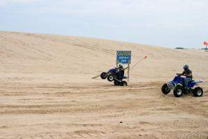 Quad ATV riding in dunes