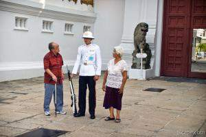Tourists checking out a gate guard