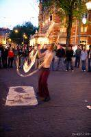 Street performer showing off fire ropes