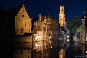 Medieval buildings and Belfry reflecting in the River Dijver
