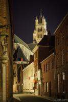 Narrow illuminated street and St Saviour Cathedral