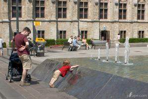 Little boy playing in the fountain