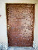 Ornately carved door of our room at the Sopa