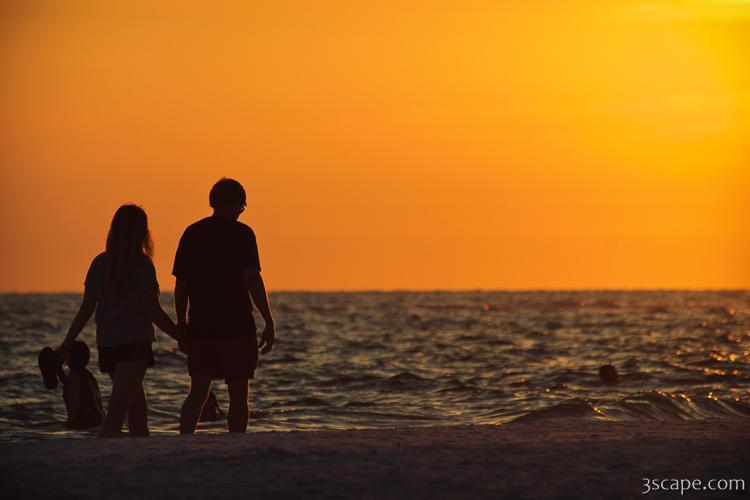 couple taking a romantic walk on the beach framed print landscape
