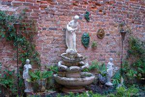Fountain and sculptures tucked away in an alley