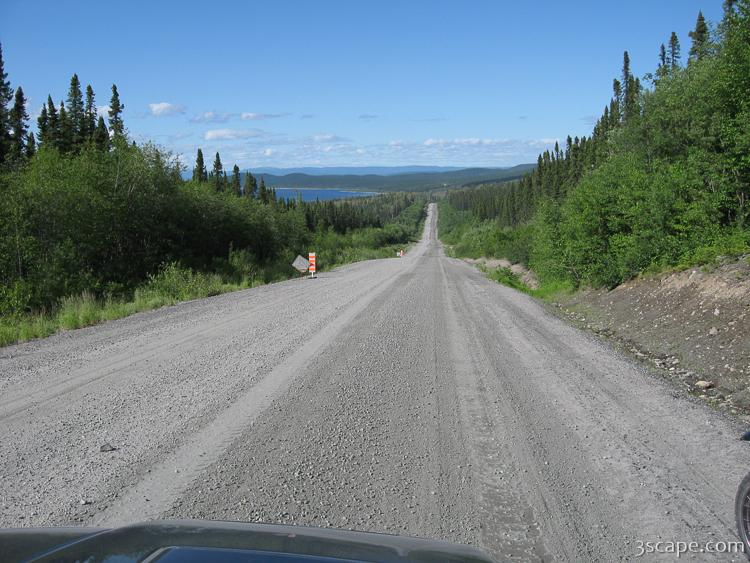 Endless gravel road with view of Manicouagan Reservoir