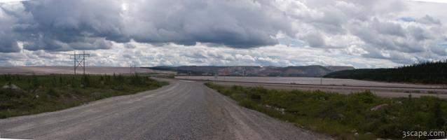 Panoramic view of iron mine, lake, and road