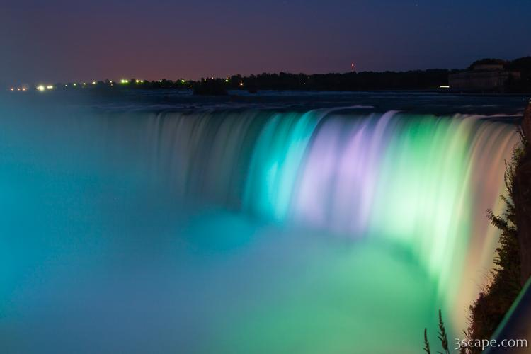 Colorful lights illuminating Niagara Falls