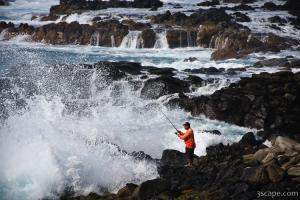 Fisherman and powerful surf near Honolua