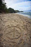 Peace sign in the sand