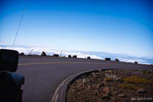 Road with no guard rail, high above the clouds