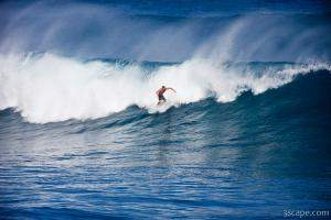 Surfer cutting a wave on Maui's north shore - Hookipa