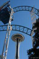 Seattle Space Needle under roller coaster