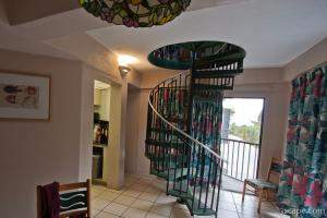 Interior of bungalo (condo) at Coco Plum Resort (spiral staircas